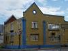 durban-point-mahatma-gandi-yellow-building-facade-s29-52-31-e31-02-23