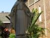 Oakford Priory Church - Statue in Quadrangle
