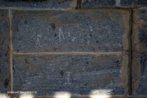 Stonemason's mark on blocks to designate workman.
